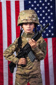 Young boy dressed like a soldier with American flag — Stock Photo