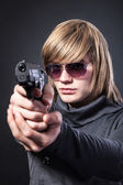 Serious man with glasses and with gun — Stock Photo