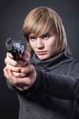 Serious man with a gun — Stock Photo