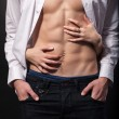 Woman's hands on a sexy man's torso — Stock Photo #41171695
