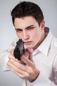 Man with a gun — Stock Photo