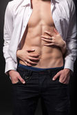 Woman's hands on a sexy man's torso — Foto Stock