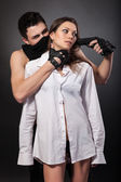 Man take a beautiful woman as a hostage — Stock Photo
