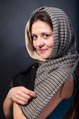 Woman shawl close up face portrait. Hand face touch. — Stock Photo