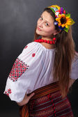 Attractive woman wears Ukrainian national dress — Stock Photo