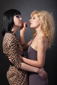 Two beautiful women lips red lipstick — Stock Photo
