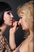 Two beautiful women lips red lipstick — Stock Photo