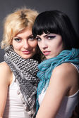 Two lesbians in scarves, are hugging — Stock Photo