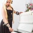 Beautiful woman in evening dress and piano — Stock Photo #41818835