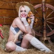 Young sexy girl in underwear sit in the barn with hay — Stock Photo