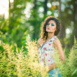 Stock Photo: Portrait of beautiful woman in a park