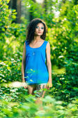 Portrait of a beautiful brunette woman outdoors — Stock Photo