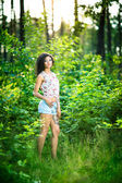 Portrait of beautiful woman standing in the forest — Stock Photo