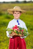 Happy farmer boy hold Organic Apples in Autumn Garden — Stock Photo