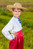 Cute child in traditional Ukrainian clothes outdoor — Stock Photo