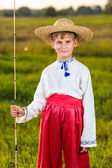 Photo of little kid pulling rod while fishing on weekend — Stock Photo