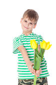 Young boy holding yellow tulips — Stock Photo