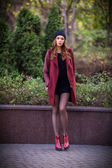 Style redhead girl at beautiful autumn alley — Stock Photo