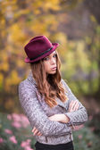 Style redhead girl at beautiful autumn alley — Stockfoto