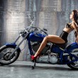 Young sexy woman sitting on motorcycle. — Stock Photo