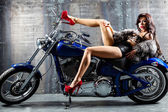 Young sexy woman sitting on motorcycle. — Stockfoto