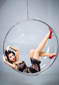 Sexy woman suspended from an aerial hoop — Stockfoto