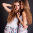 Two beautiful girls twins, isolated on black — Stock Photo