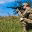 Soldier with a rifle — Stock Photo #44109961