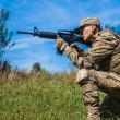 Soldier with a rifle — Stock Photo #44110035