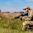 Soldier with a rifle — Stock Photo