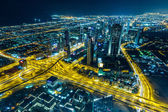 Dubai downtown night scene with city lights — Stock Photo
