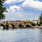 Karlov or charles bridge and river Vltava in Prague in summer — Stock Photo #44717815