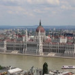 View of a building of the Hungarian parliament, Danube and chain Secheni Bridge — Stock Video #45685711
