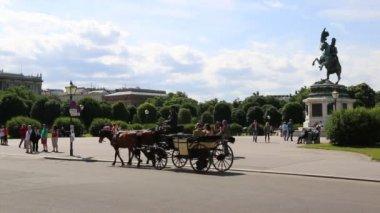 The Hofburg palace in Michaelerplatz square circa — Stock Video