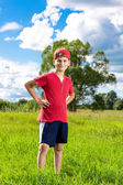 Smiling ten years old boy outdoors — Stock Photo
