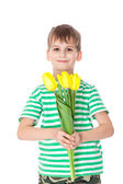 Young boy holding tulips — Stock fotografie