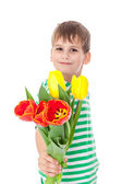Young boy holding tulips — Photo