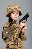 Young boy dressed like a soldier with a gun — Foto Stock
