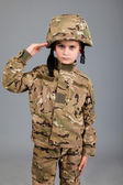 Saluting soldier. Young boy dressed like a soldier — Stock Photo