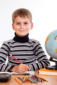 Cute schoolboy is writting — Stok fotoğraf