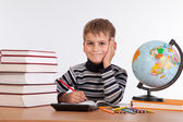 Cute schoolboy is writting — Stock Photo
