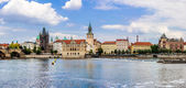 Karlov or charles bridge and river Vltava in Prague in summer — Stock fotografie