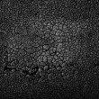 Black cracked abstract texture background. — Stock Photo