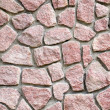Red granite masonry wall closeup background. — Stock Photo