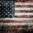 Stock Photo: Grungy americflag background.