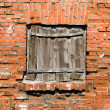Stock Photo: Blocked window on red brick wall background.