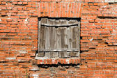 Blocked window on the red brick wall background. — Stock Photo