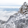 Stock Photo: Mountain over clouds