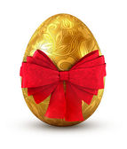 Gold egg with red bow isolated on white background. — Stock Photo