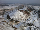 Snow-covered slagheap (aerial view). — Stock Photo